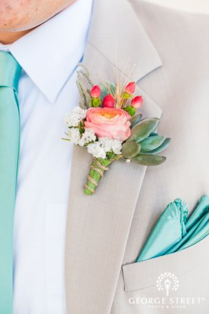 Pink ranunculus and green succulent boutonniere
