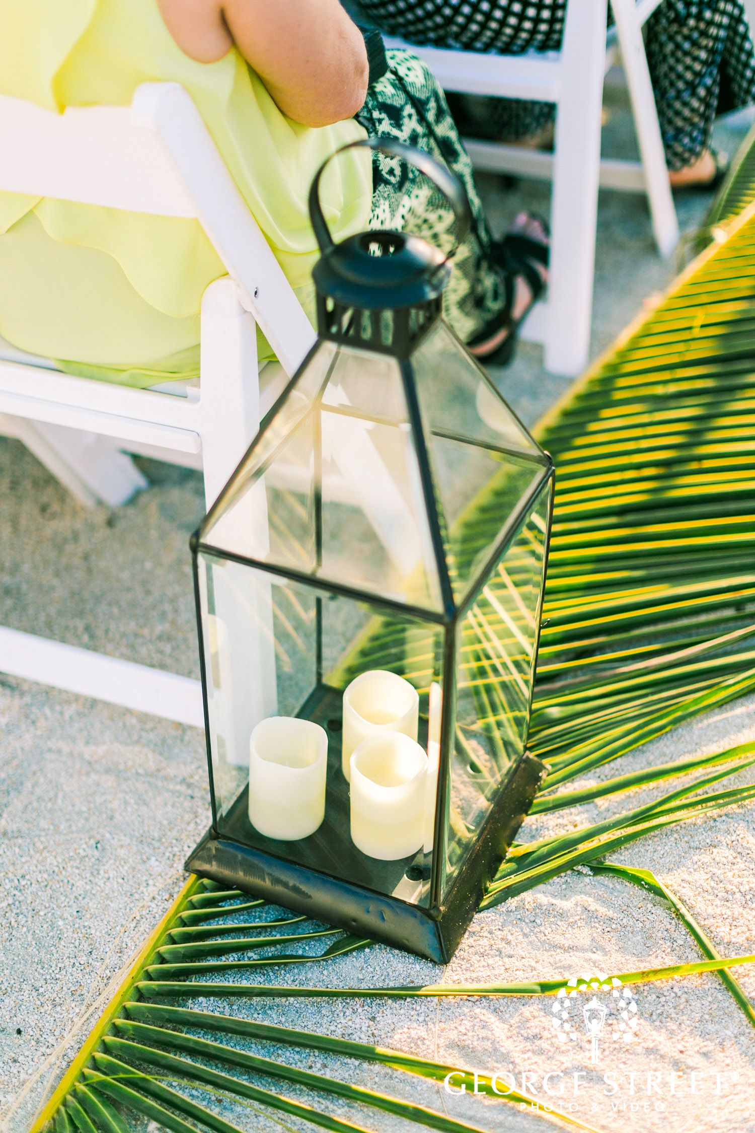 candles and palm fronds beach wedding decor