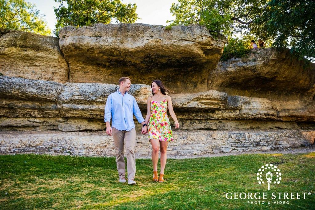 zilker metropolitan park casual rock wall austin engagement photos 7 1024 683