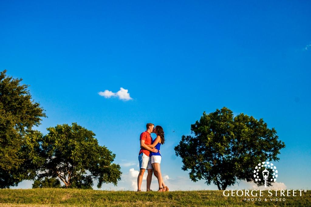 zilker metropolitan park cute tree sky sunrays austin engagement photos 1024 682