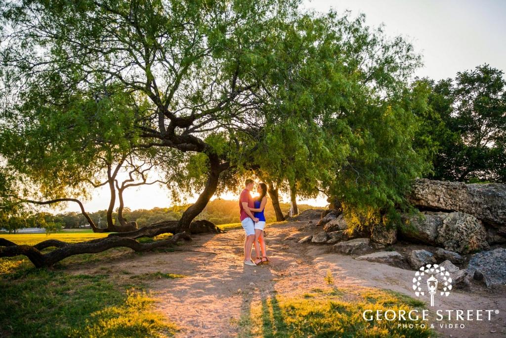 zilker metropolitan park romantic tree sunrays austin engagement photos 1024 683