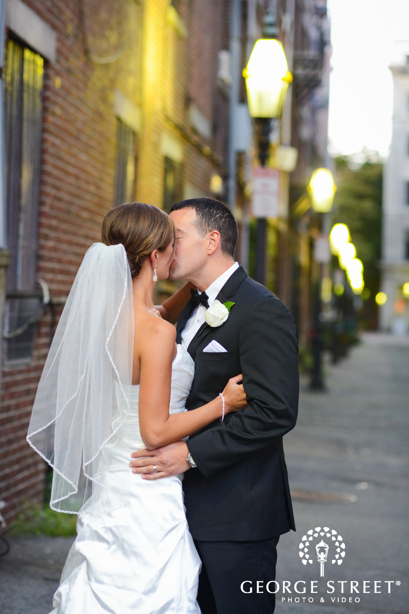 bride and groom kissing outdoors 3