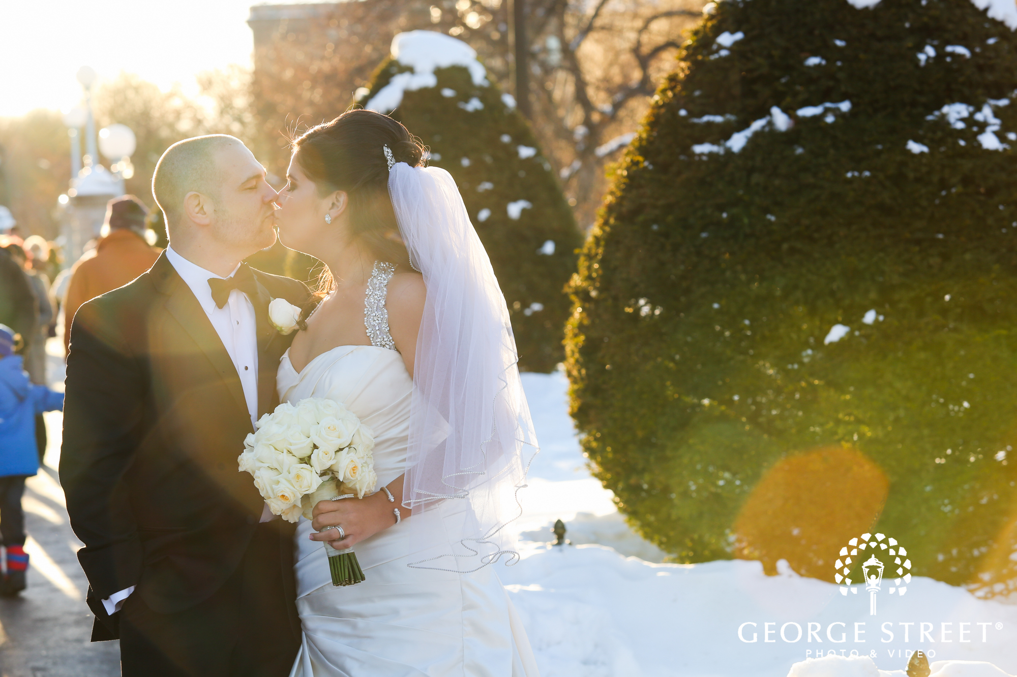 bride and groom kissing outdoors 4