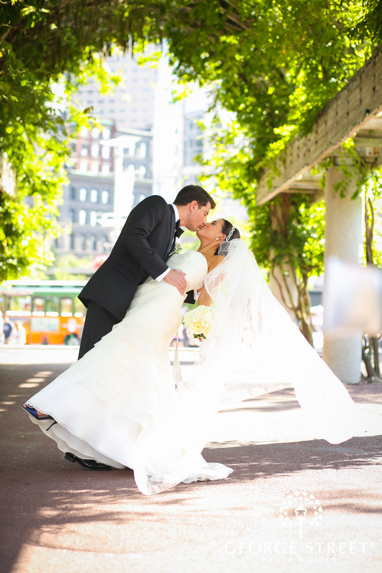 bride and groom kissing outdoors 2