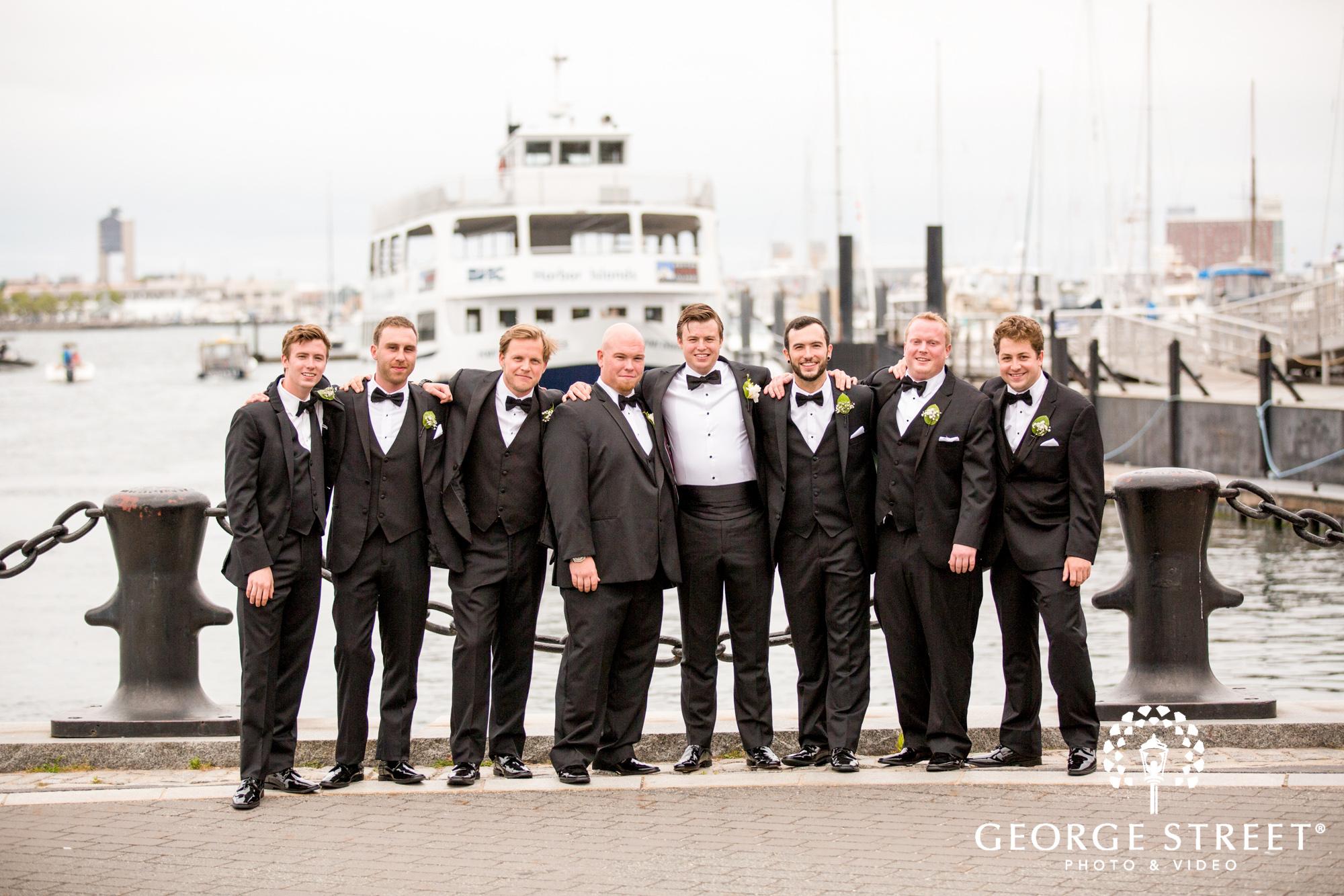 boston marriott long wharf beautiful outdoor wedding groomsmen portraits on the water