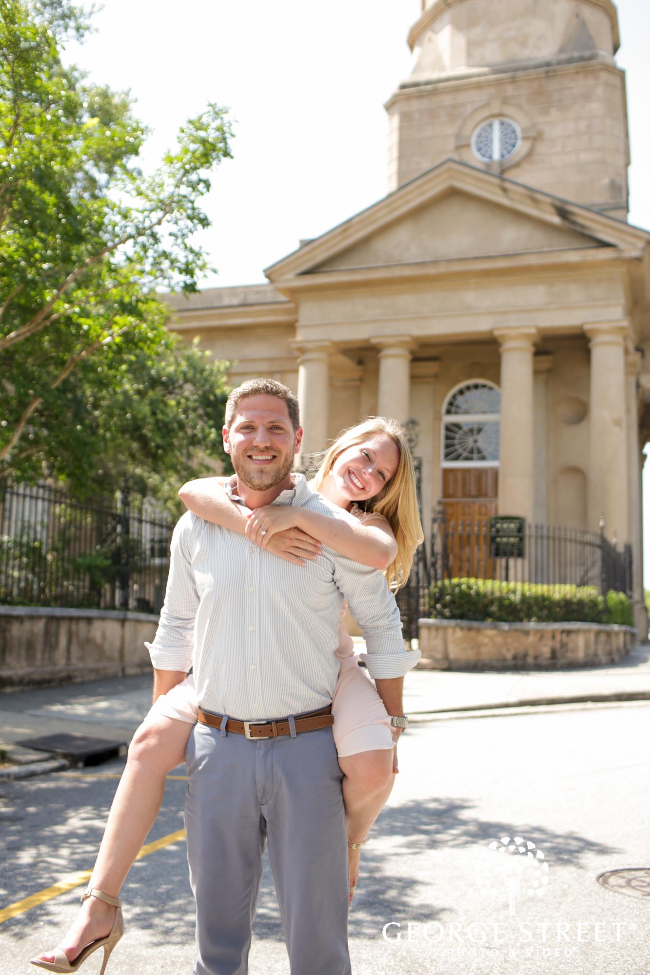 charleston historic district sunny outdoor engagement portraits  10