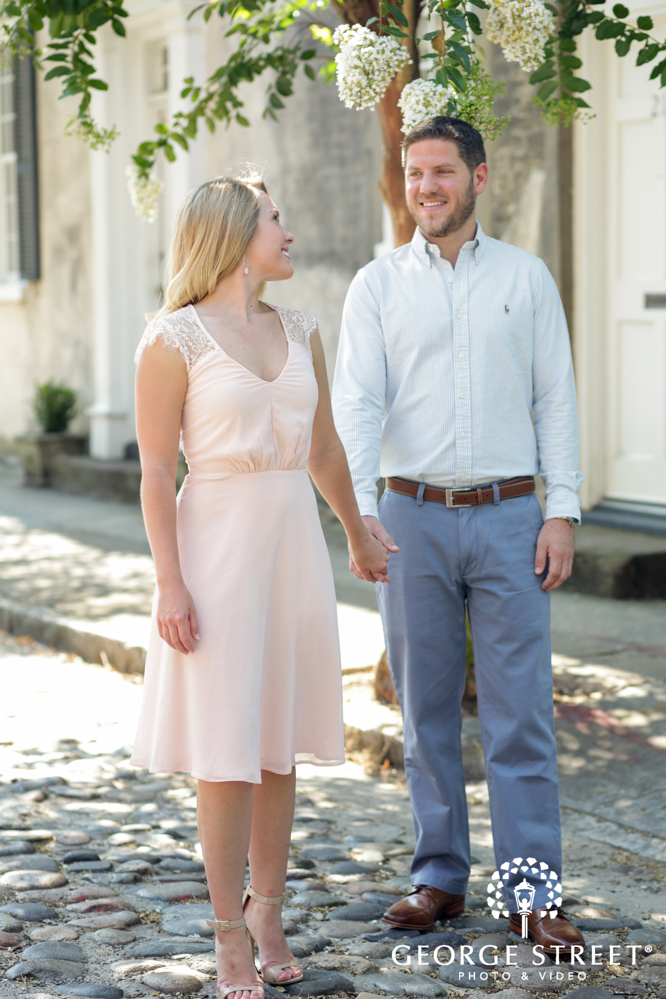 charleston historic district sunny outdoor engagement portraits candid 2