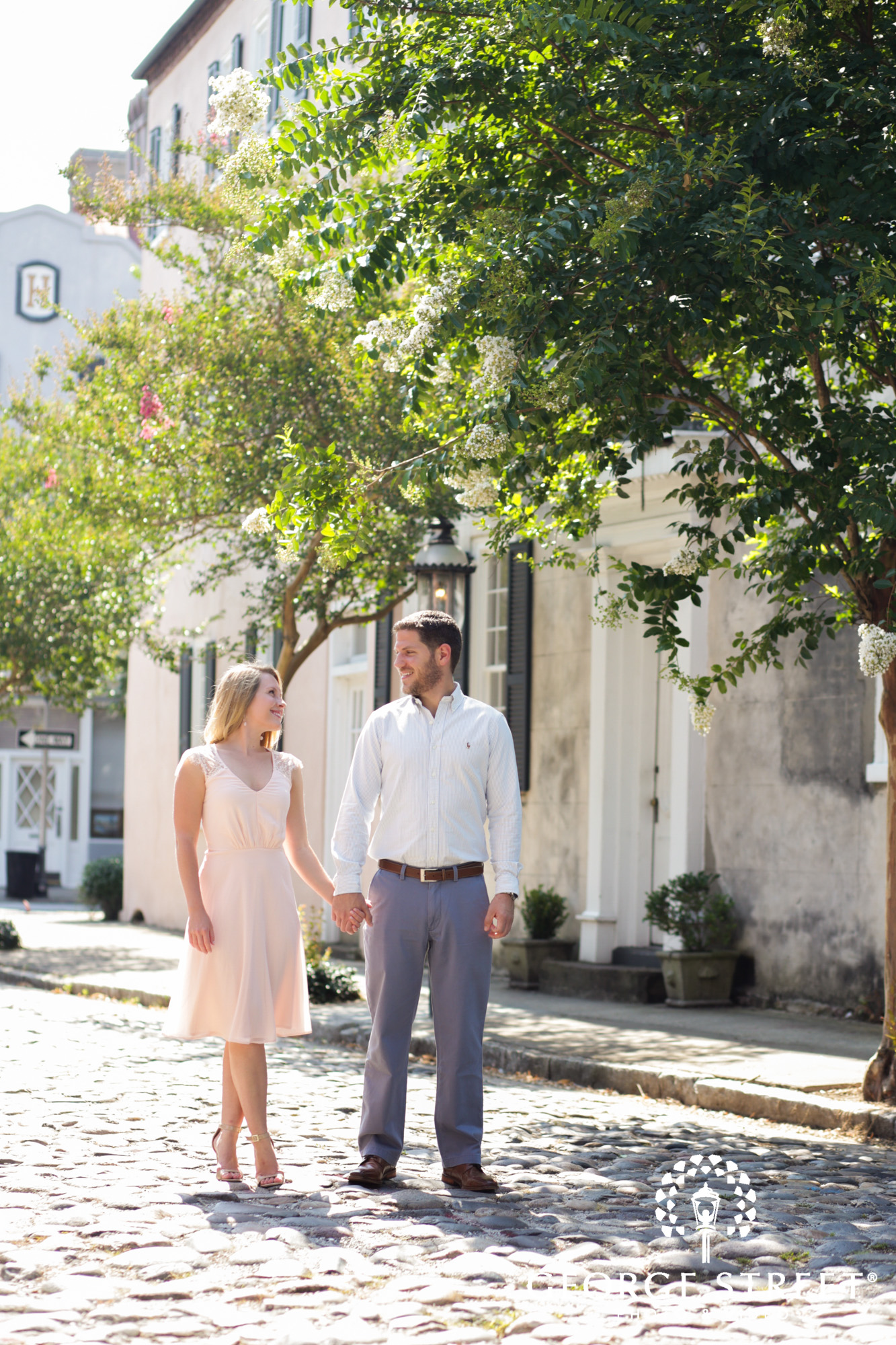 charleston historic district sunny outdoor engagement portraits candid
