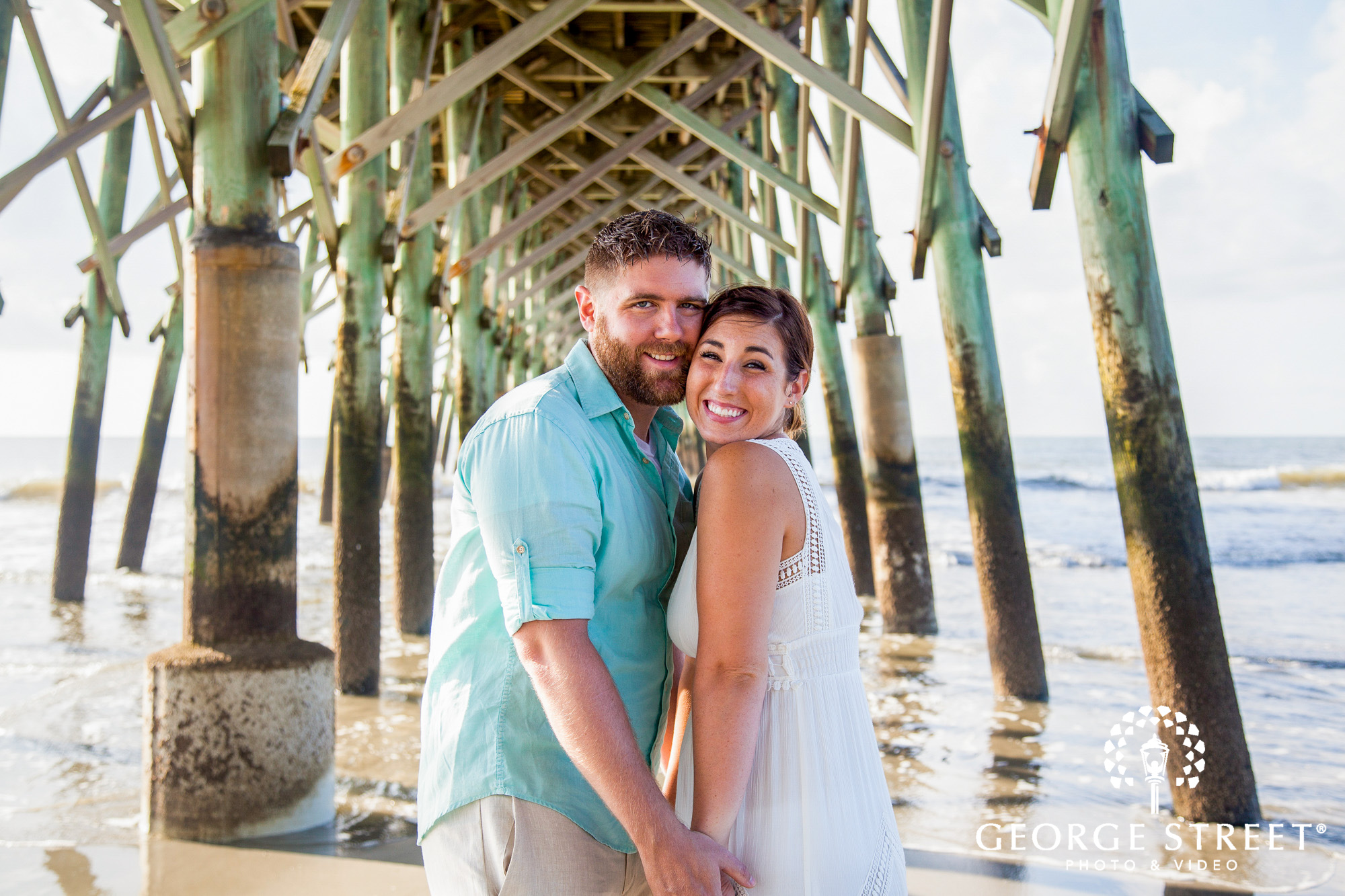 beautiful charleston engagement session at tides folly beach pier 2