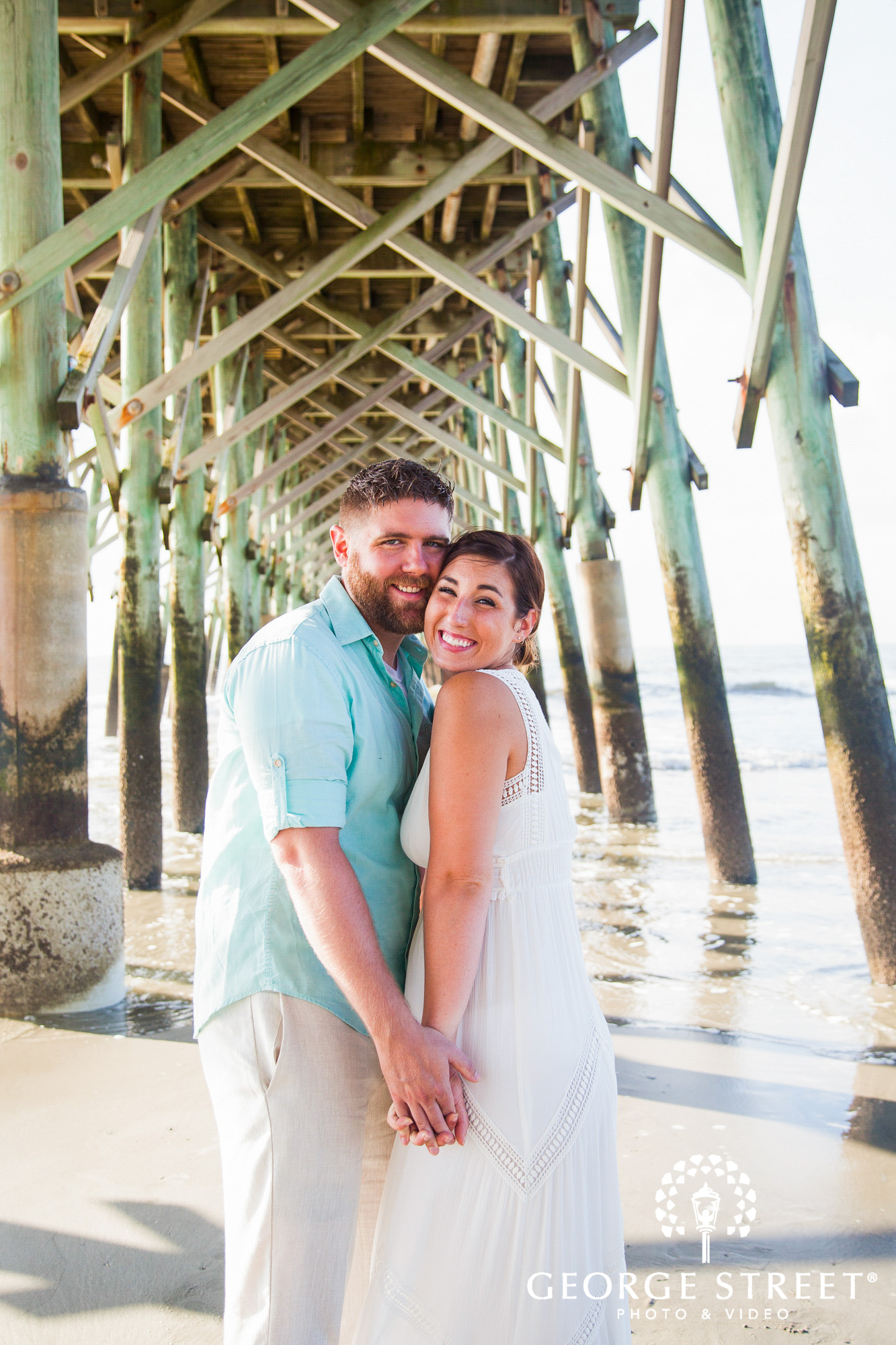 beautiful charleston engagement session at tides folly beach pier 3