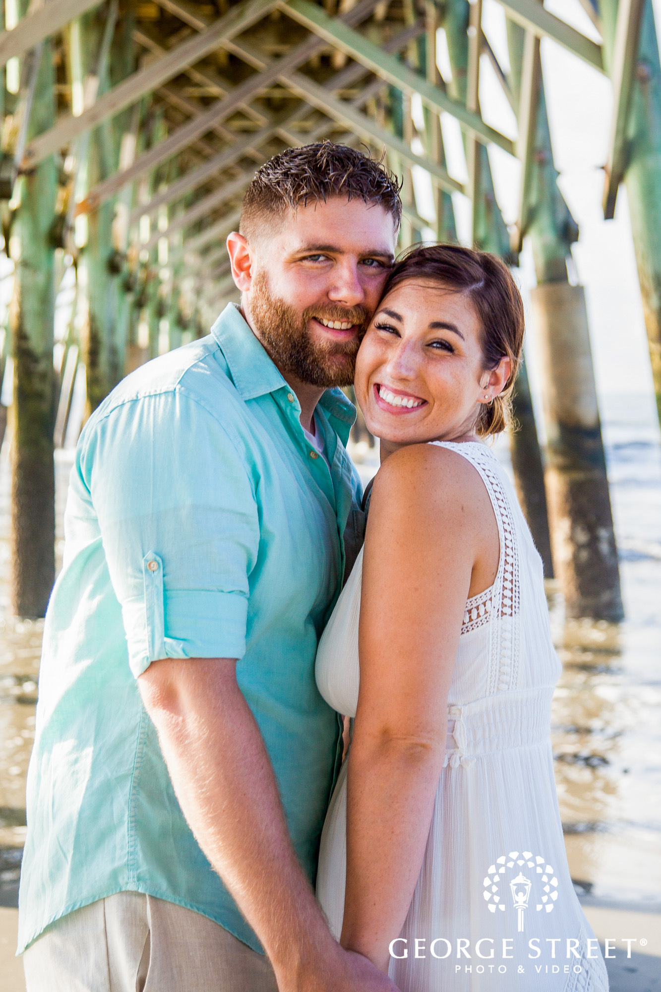 beautiful charleston engagement session at tides folly beach pier 4
