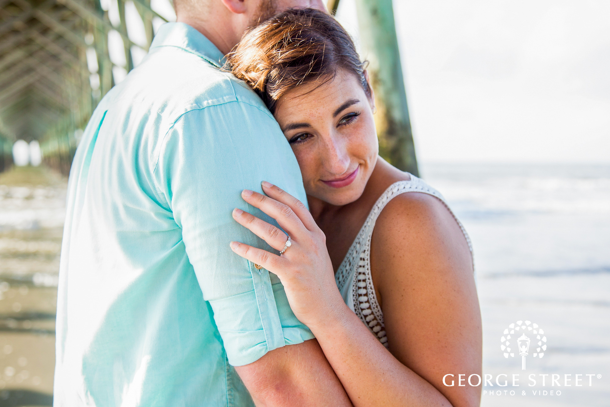 beautiful charleston engagement session at tides folly beach pier