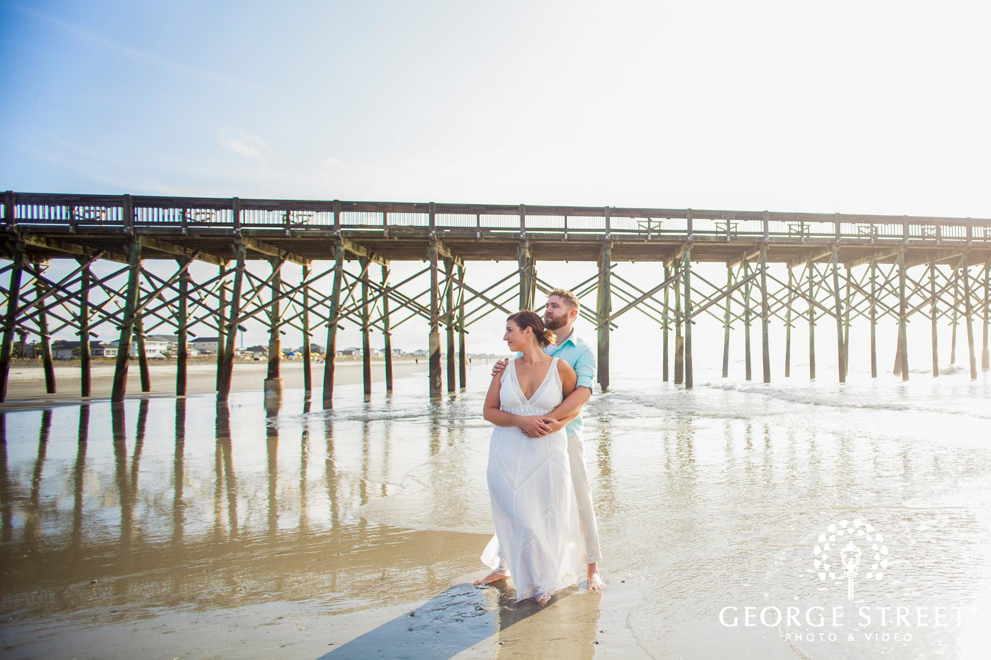 beautiful engagement photos at folly beach pier charleston 3