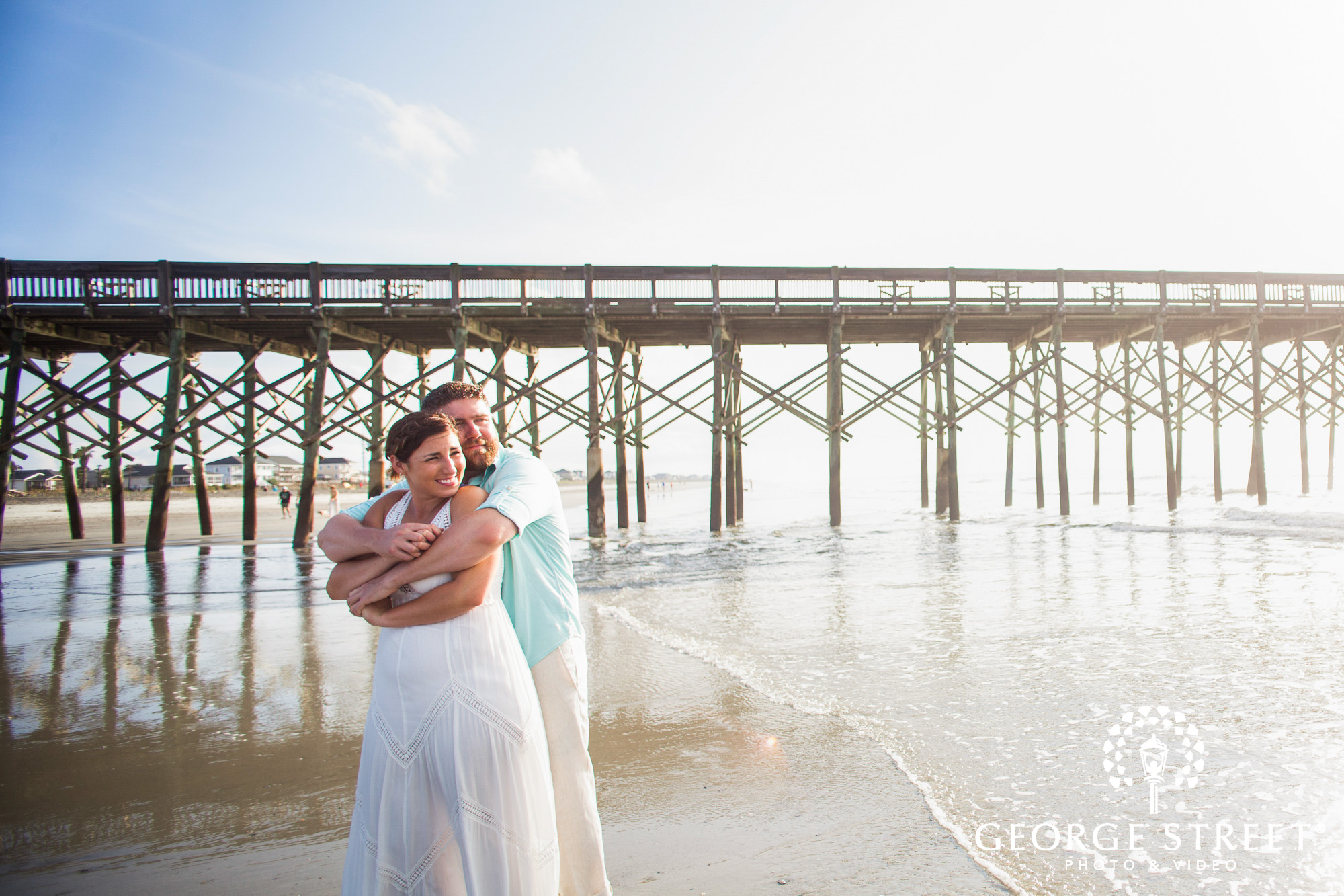 beautiful engagement photos at folly beach pier charleston