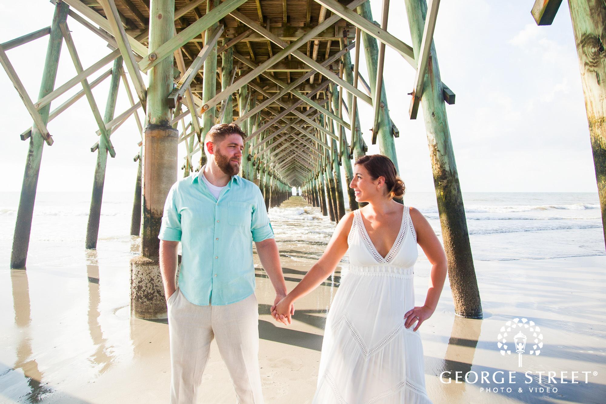 gorgeous charleston engagement photos at folly beach pier 2