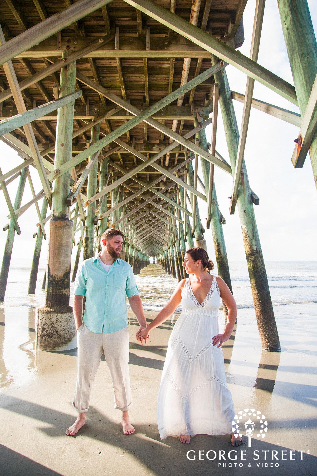 gorgeous charleston engagement photos at folly beach pier 3