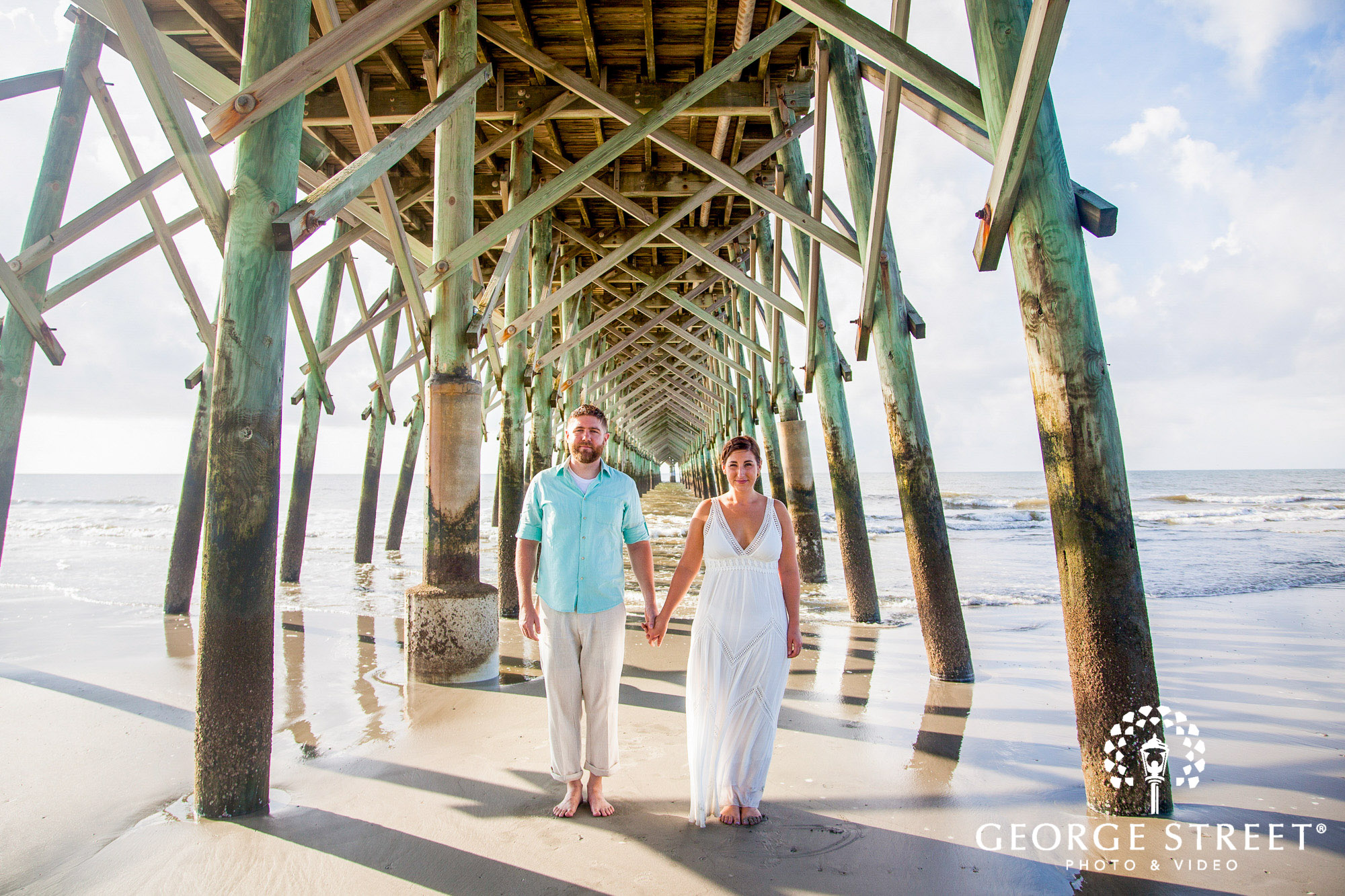 gorgeous charleston engagement photos at folly beach pier 4