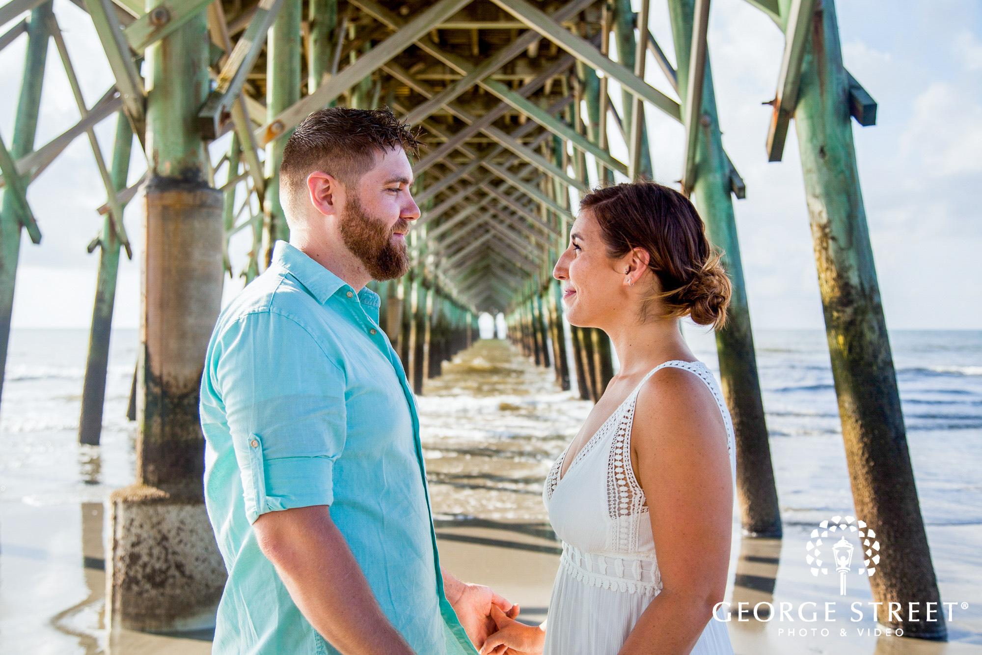 gorgeous charleston engagement photos at folly beach pier 5