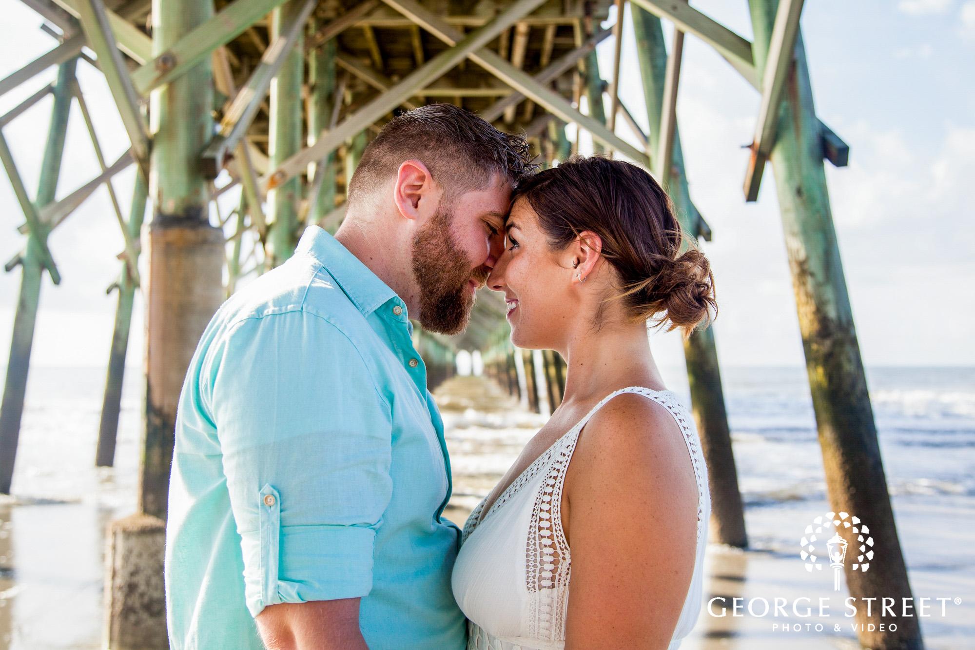 gorgeous charleston engagement photos at folly beach pier 6