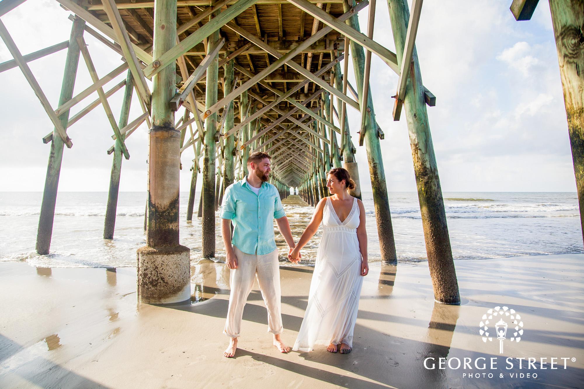 gorgeous charleston engagement photos at folly beach pier