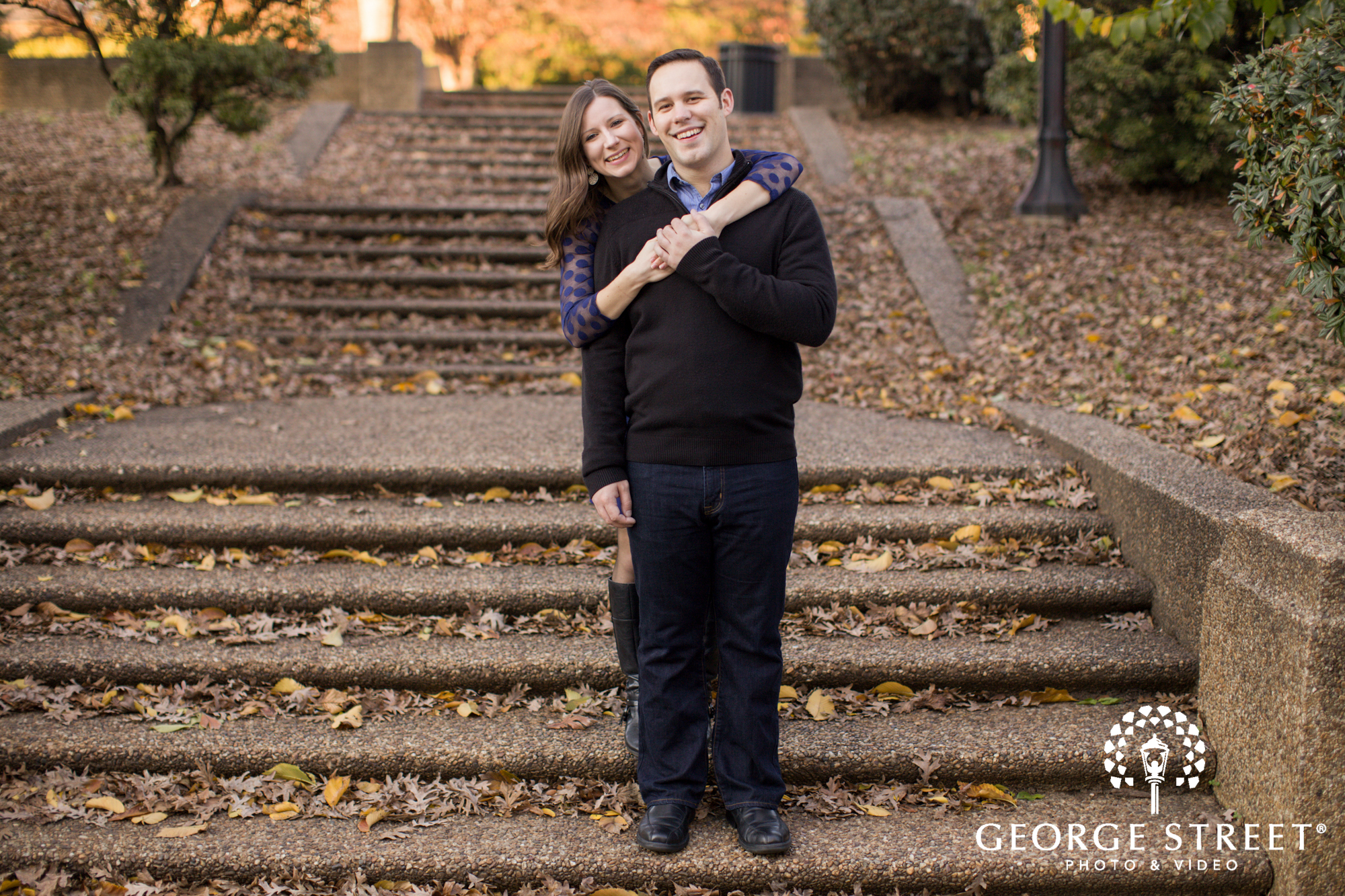 classic fall engagement portrait with leaves