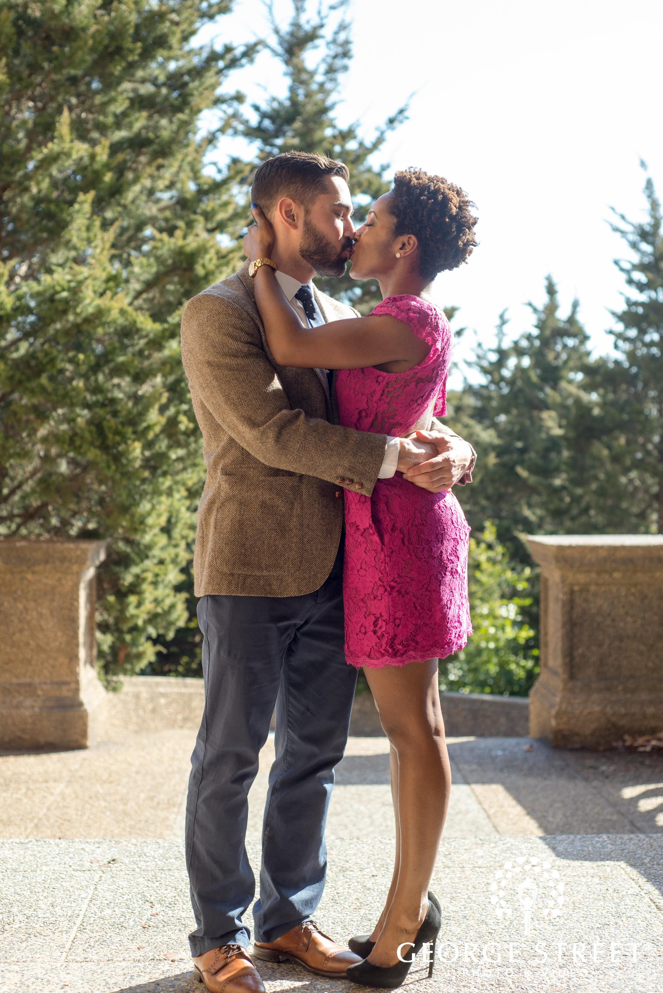 kissing couple outdoor portrait session