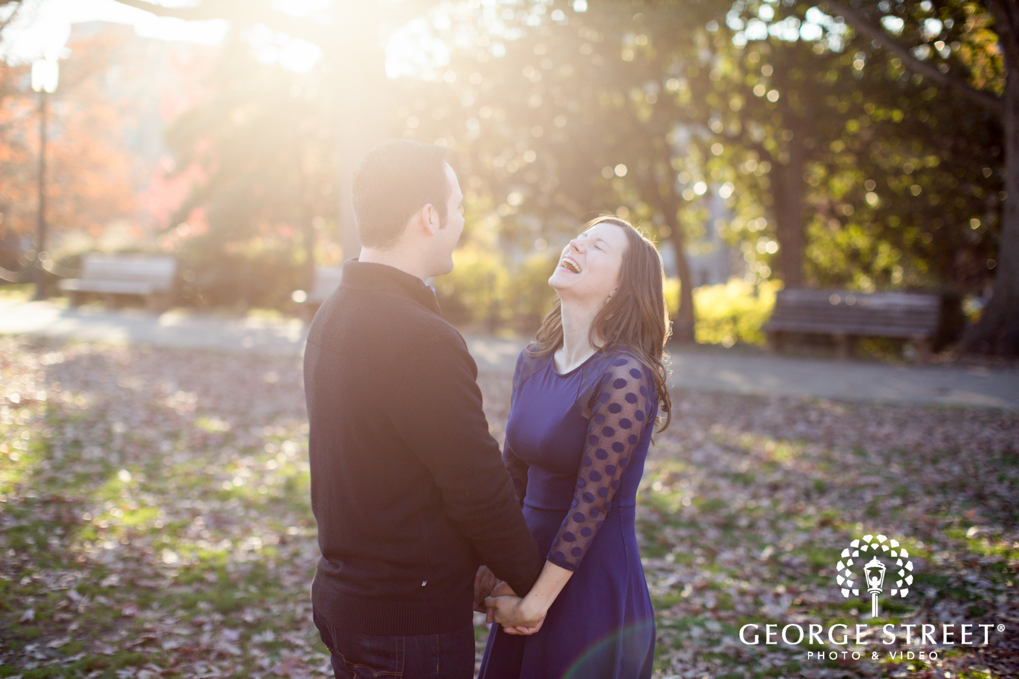 laughing couple golden hour engagement portrait