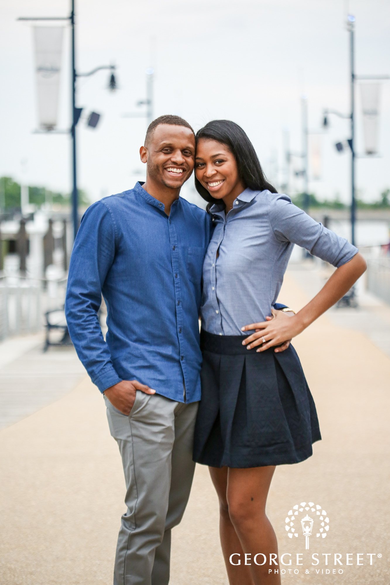 cheerful candid engagement photos at the national harbor washington dc 6