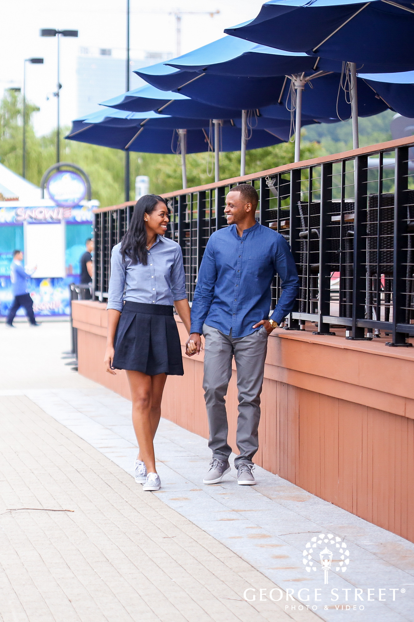 cheerful candid engagement photos at the national harbor washington dc 2