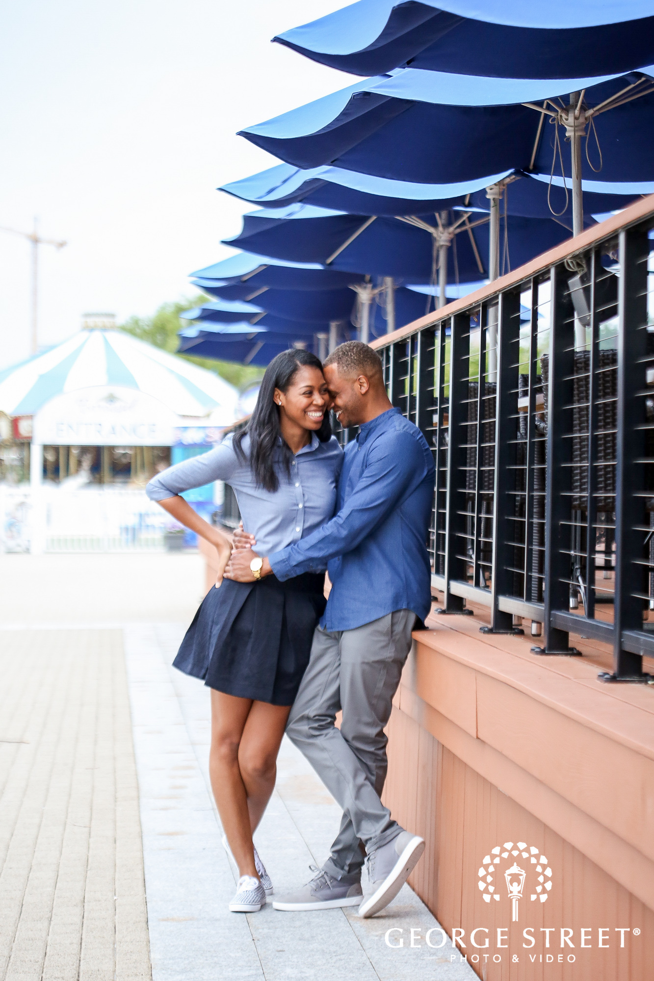 cheerful candid engagement photos at the national harbor washington dc 3