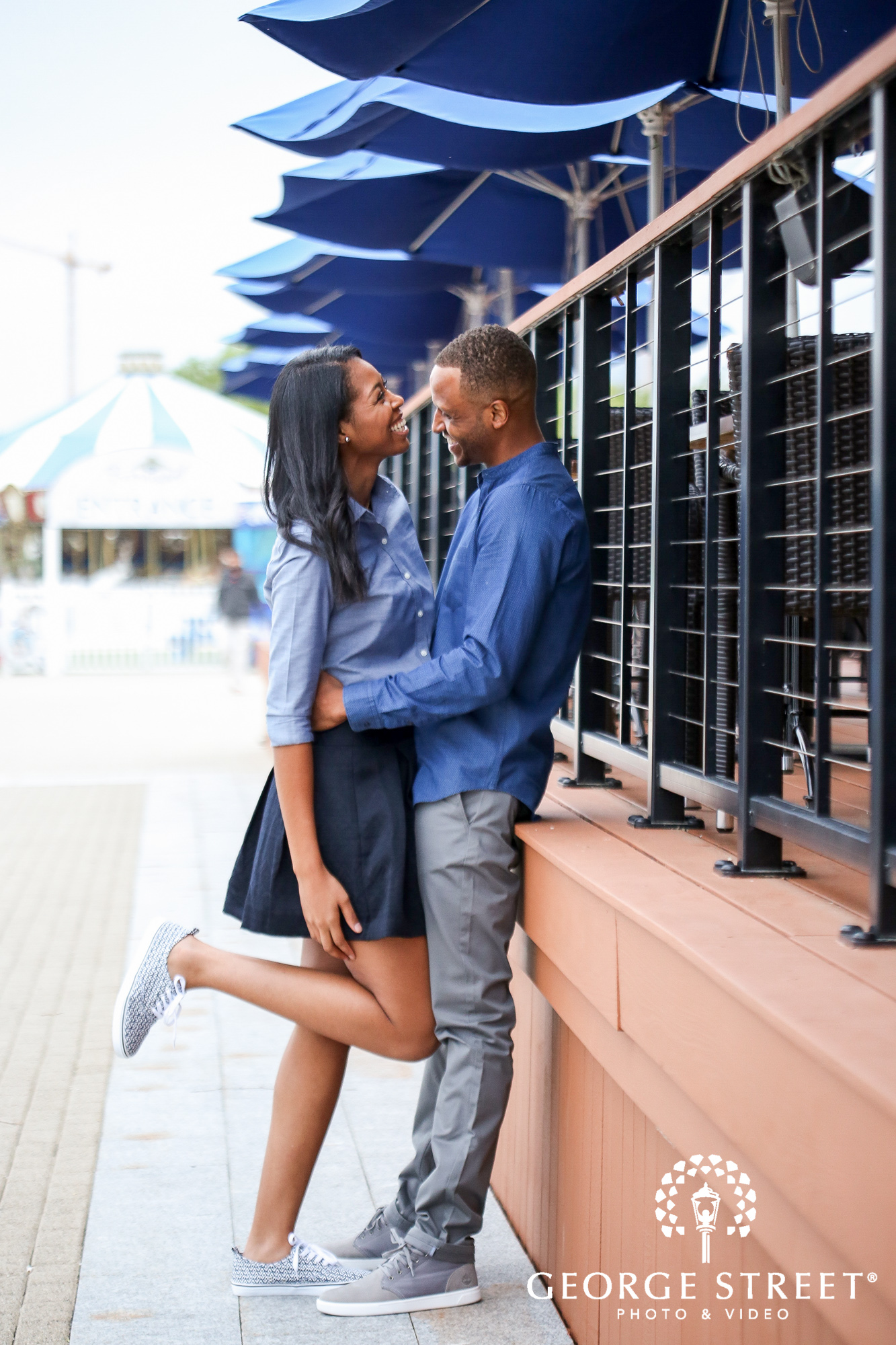cheerful candid engagement photos at the national harbor washington dc 4