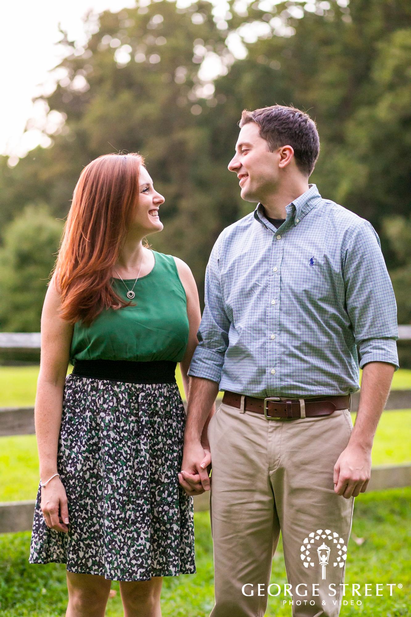 smiling couple natural light engagement portrait