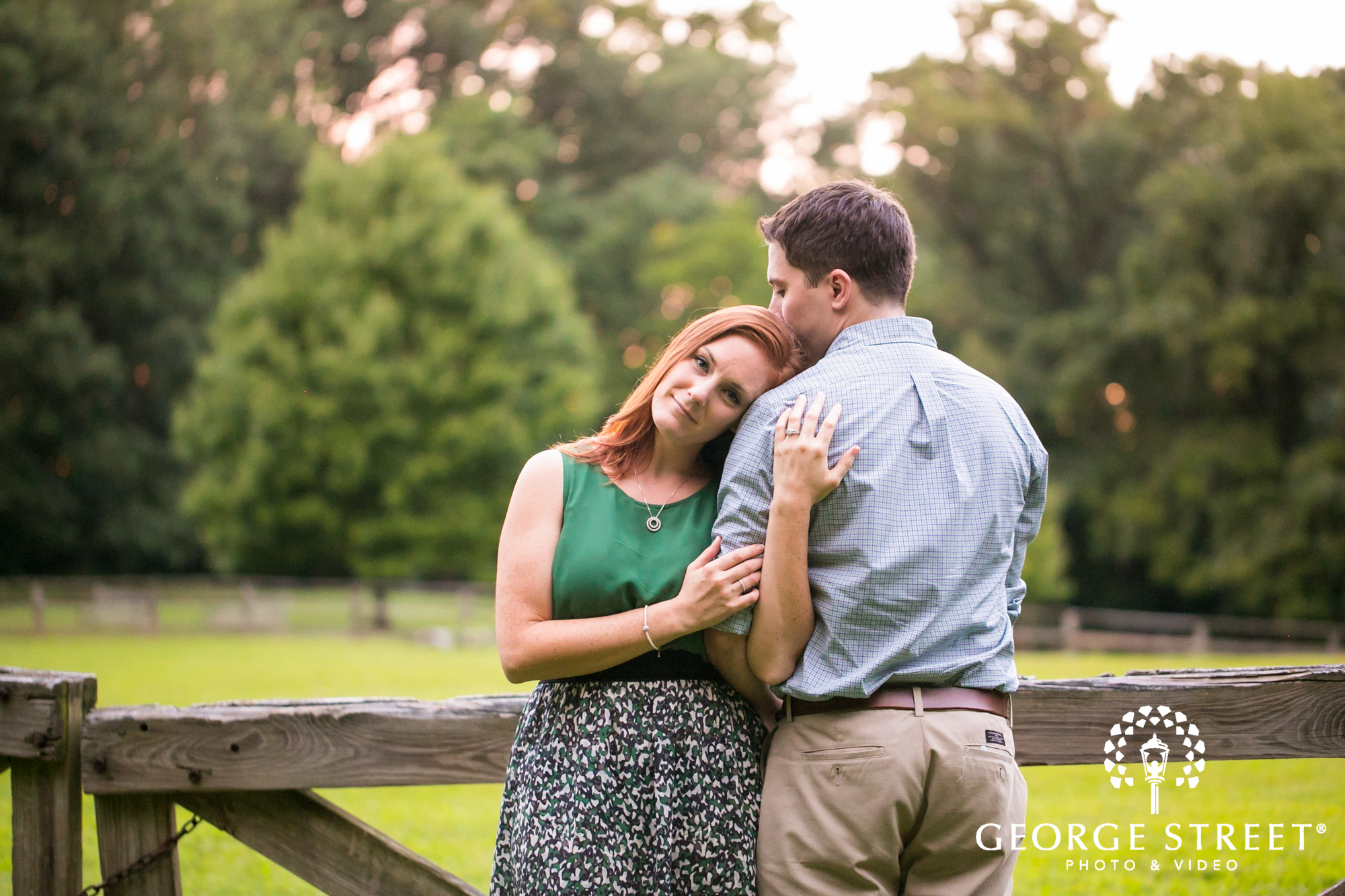 bride to be leaning on groom engagement portrait