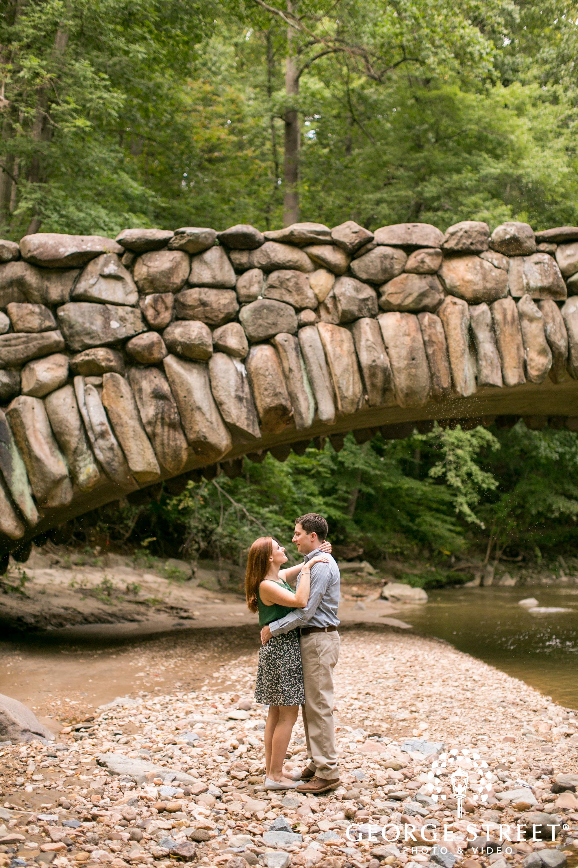 couple by stone bridge