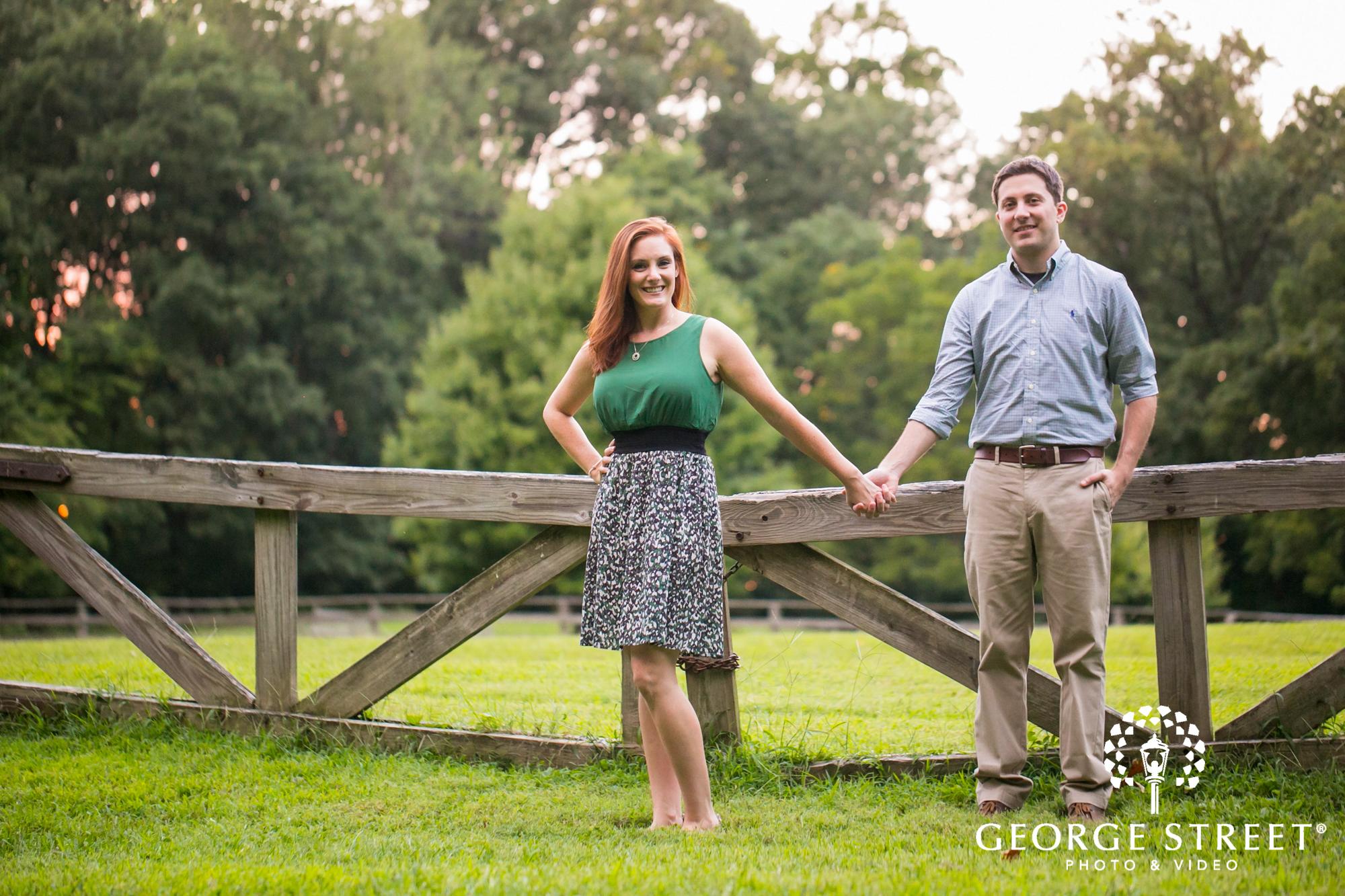 couple holding hands rural engagement portrait 2