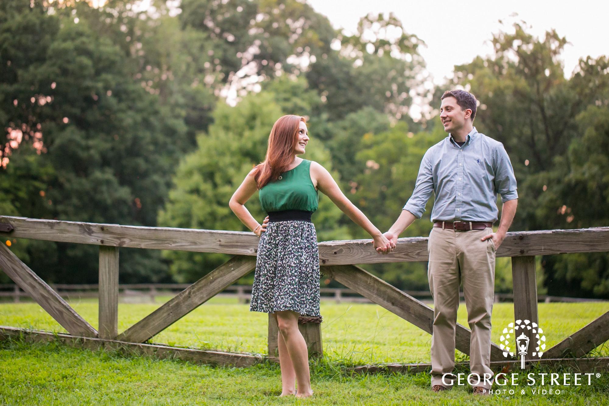 couple holding hands rural engagement portrait