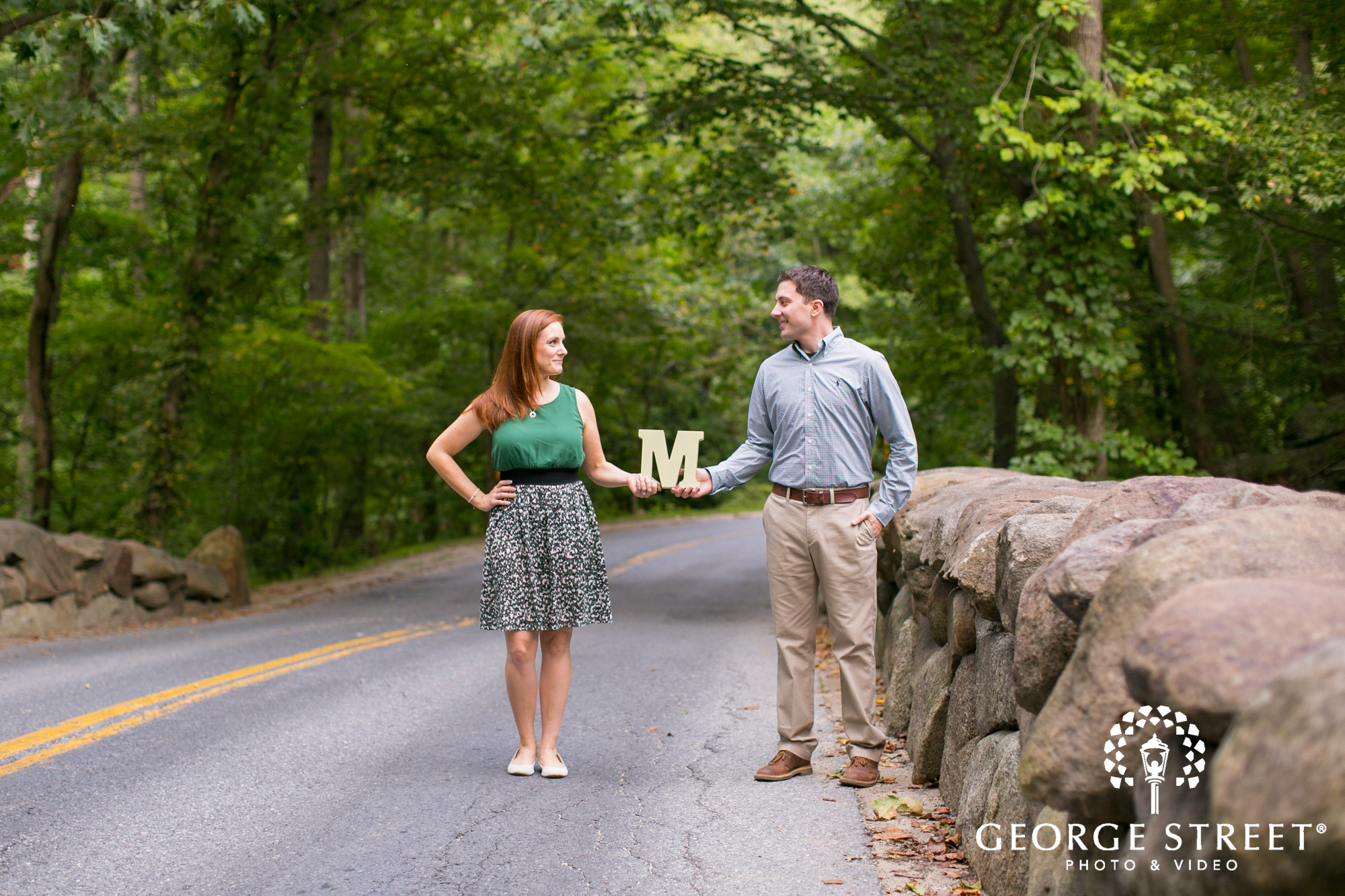 couple holding letter on rural road