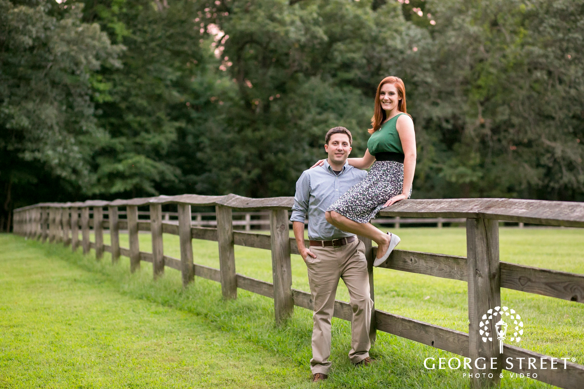 couple sitting on fence rural portrait session
