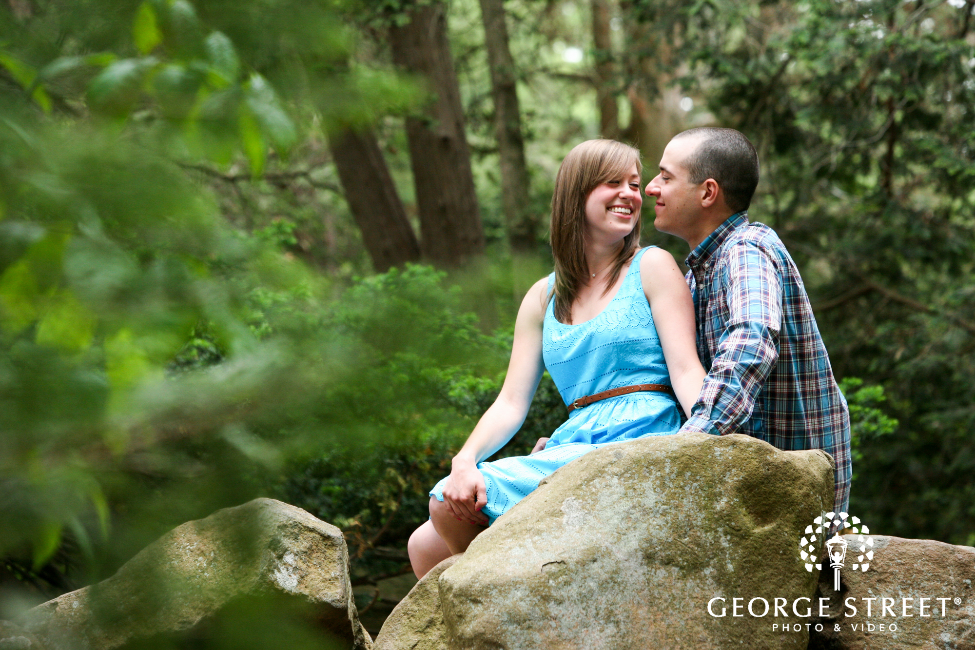candid couple engagement portrait in forrest setting