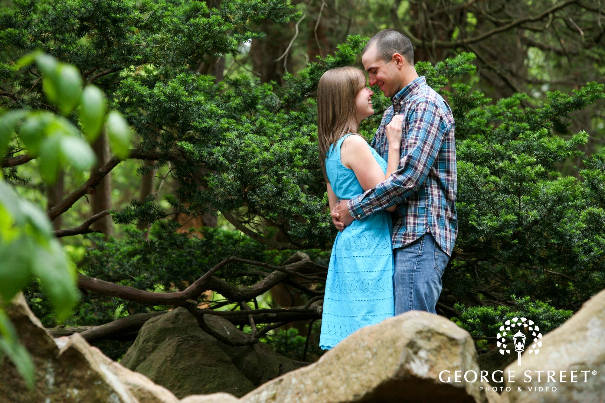 laughign couple woodland engagement portrait
