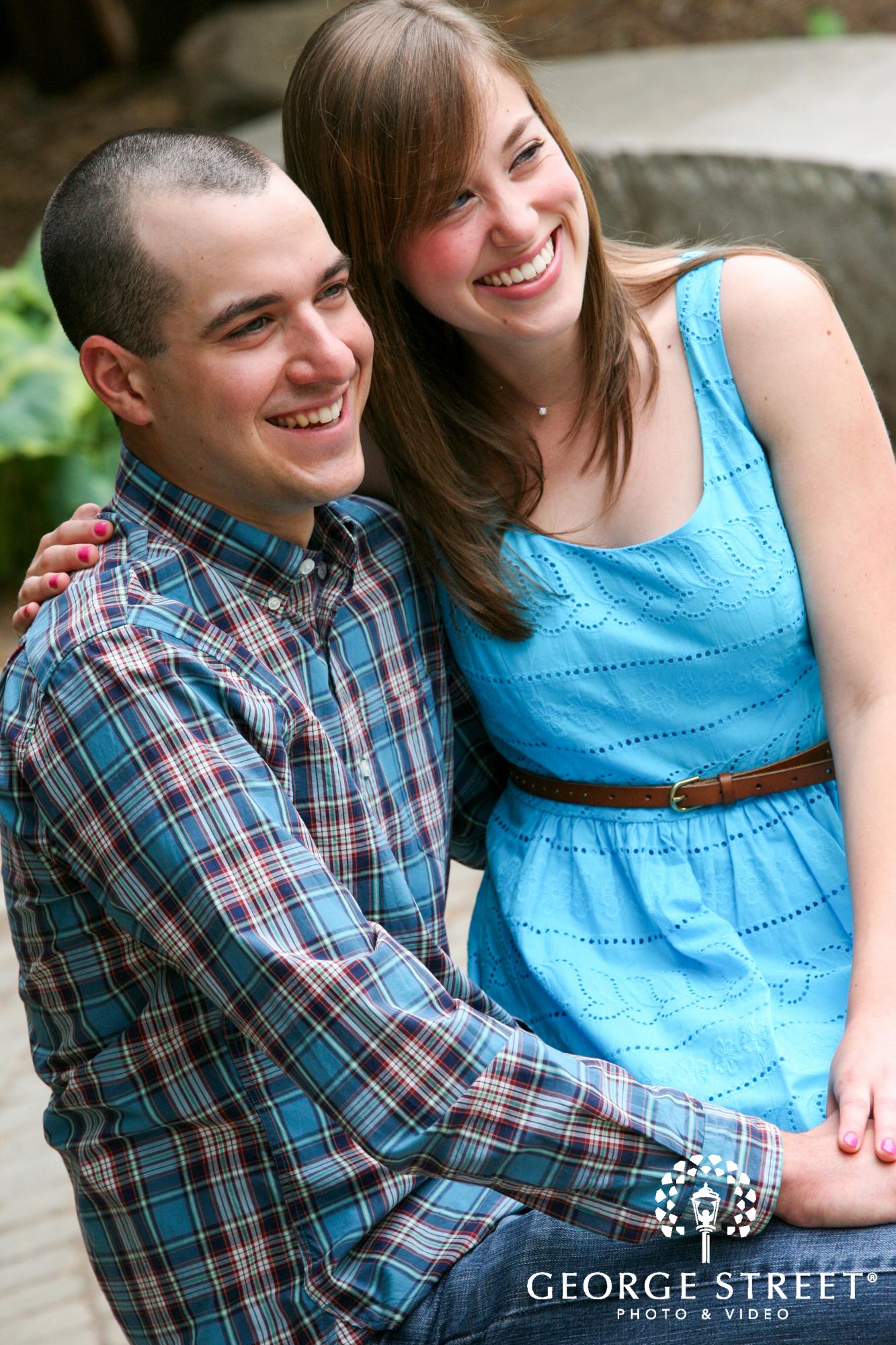 laughing couple outdoor engagement portrait