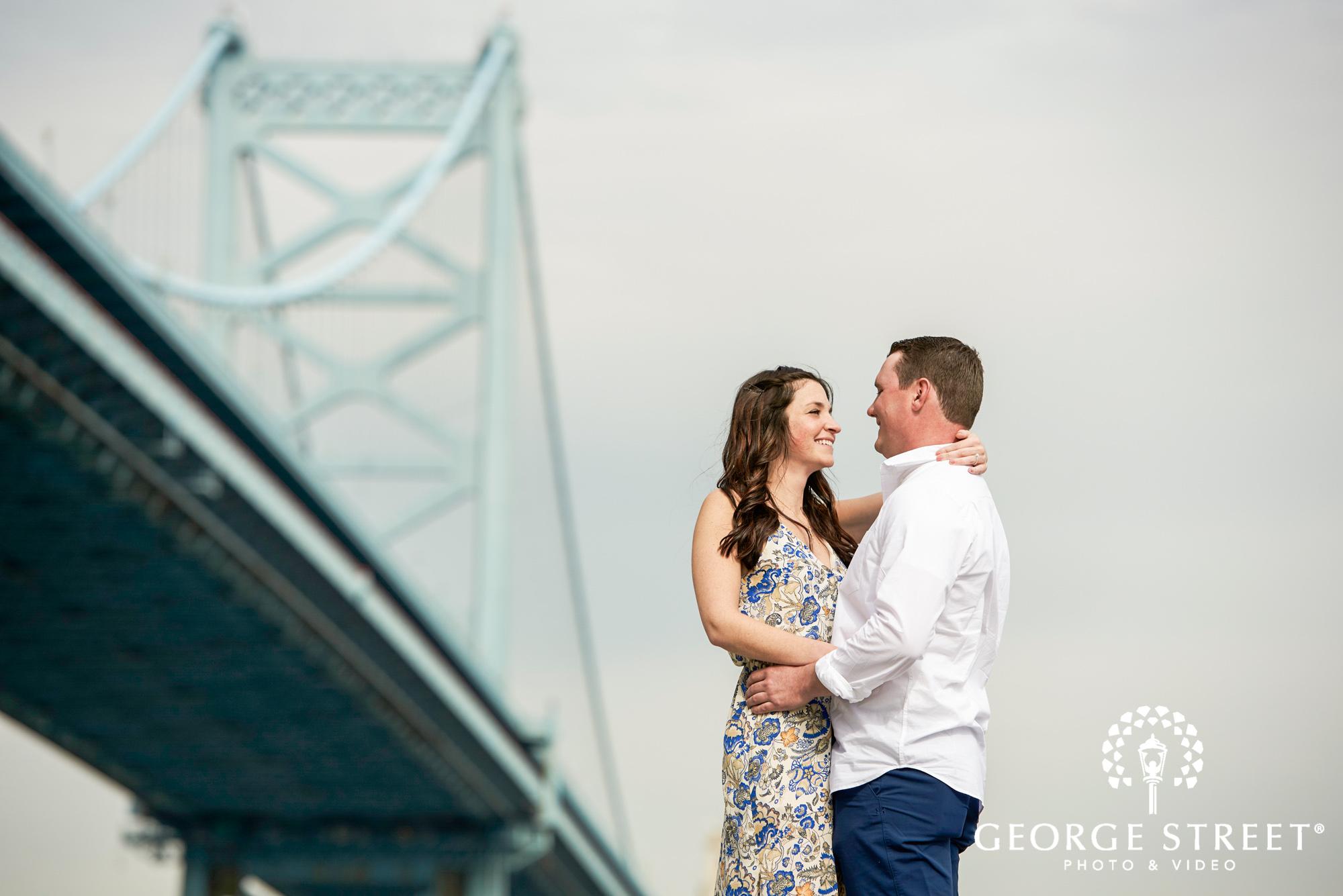 philadelphia engagement photos by the benjamin franklin bridge 3