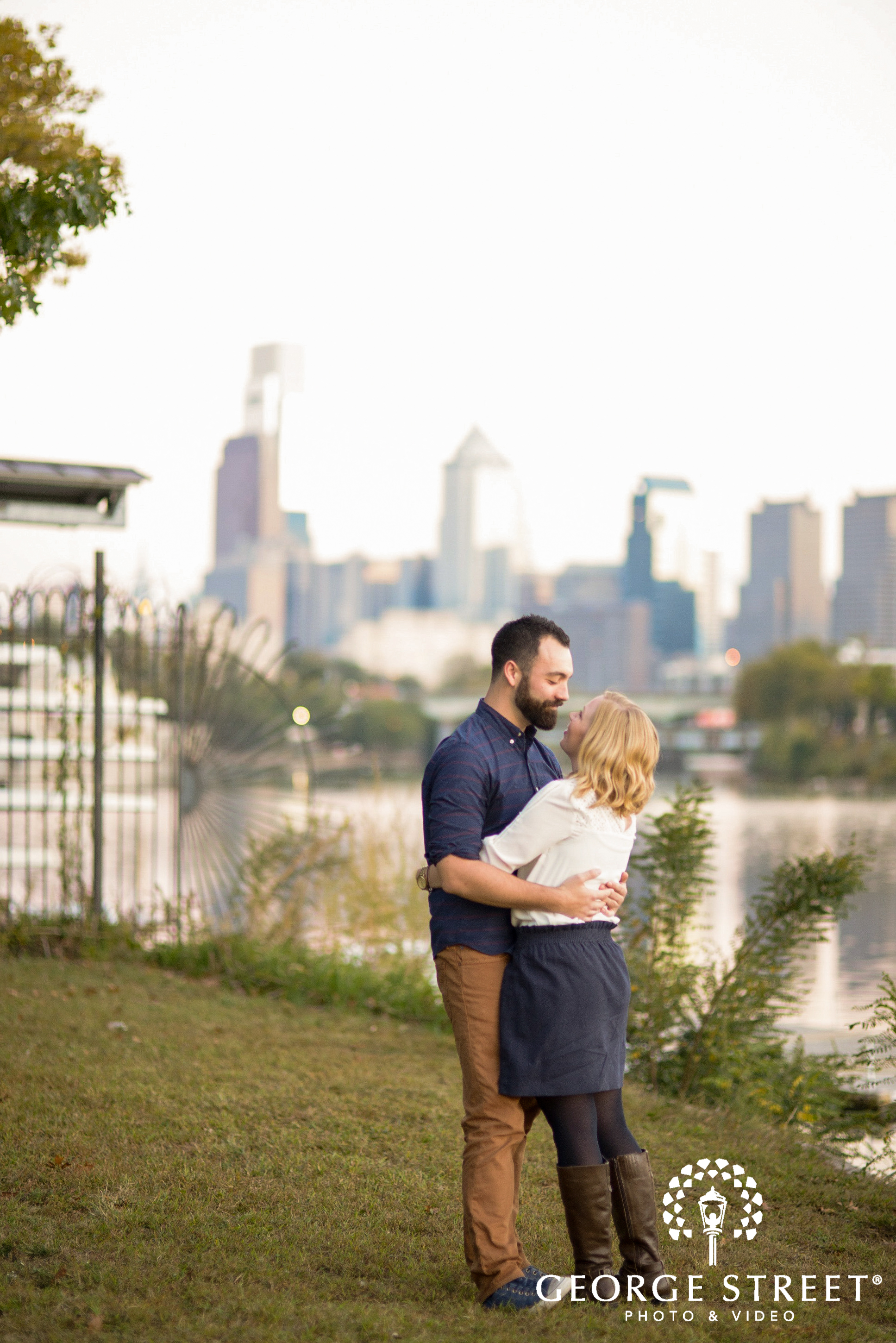 city views in background of couple