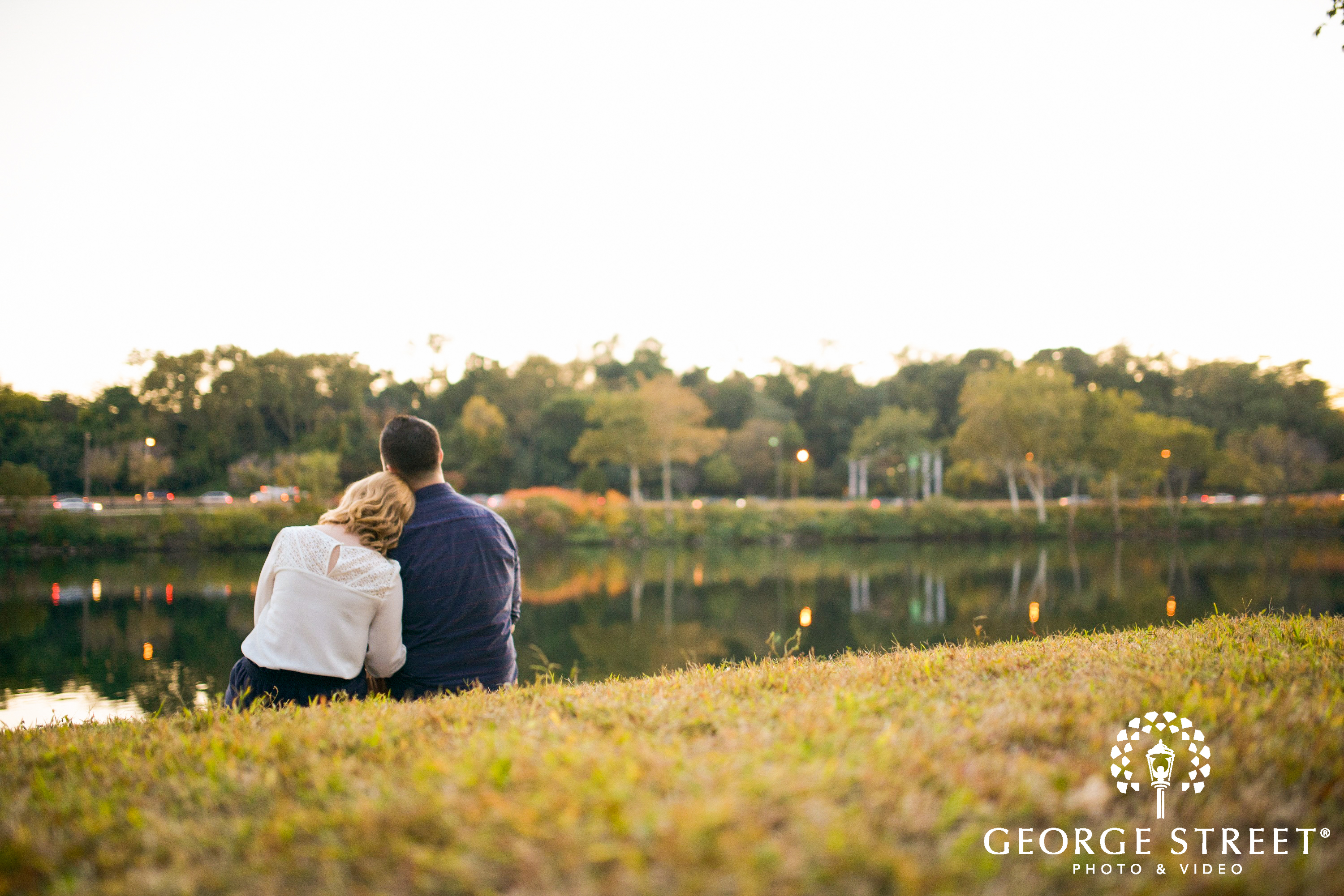 couple in love sitting on lawn