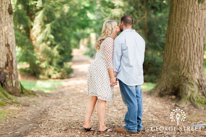 bride kissing groom in philadelphia forest