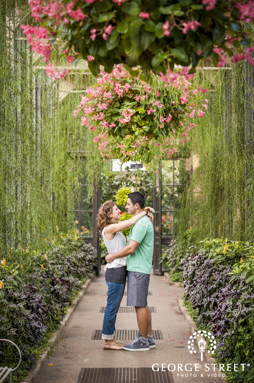 couple hugging in gardens