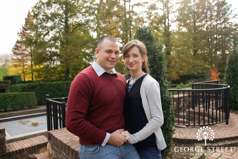 couple sitting on brick ledge
