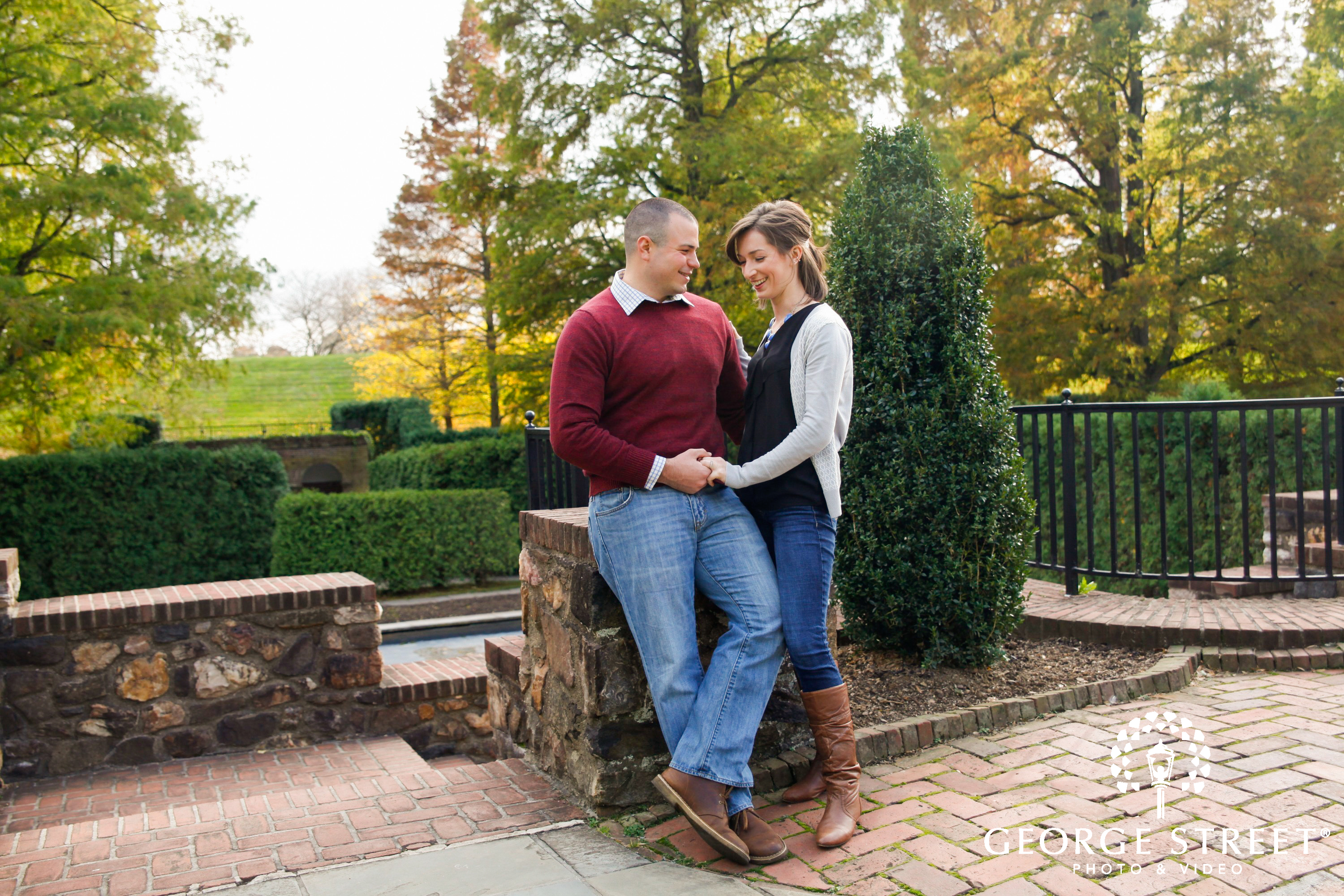 funn couple standing outside engagement session