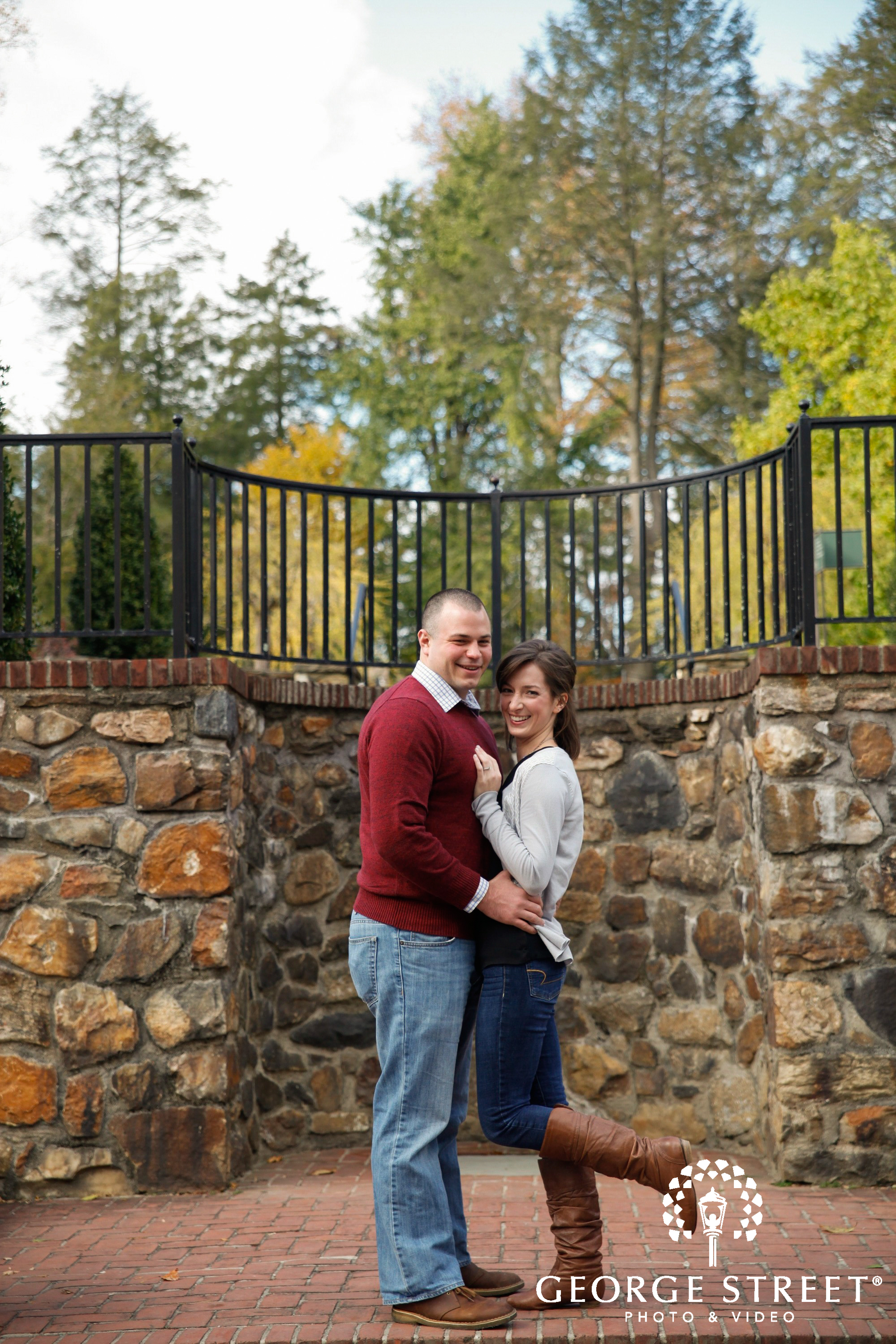 happy couple in front of stone wall