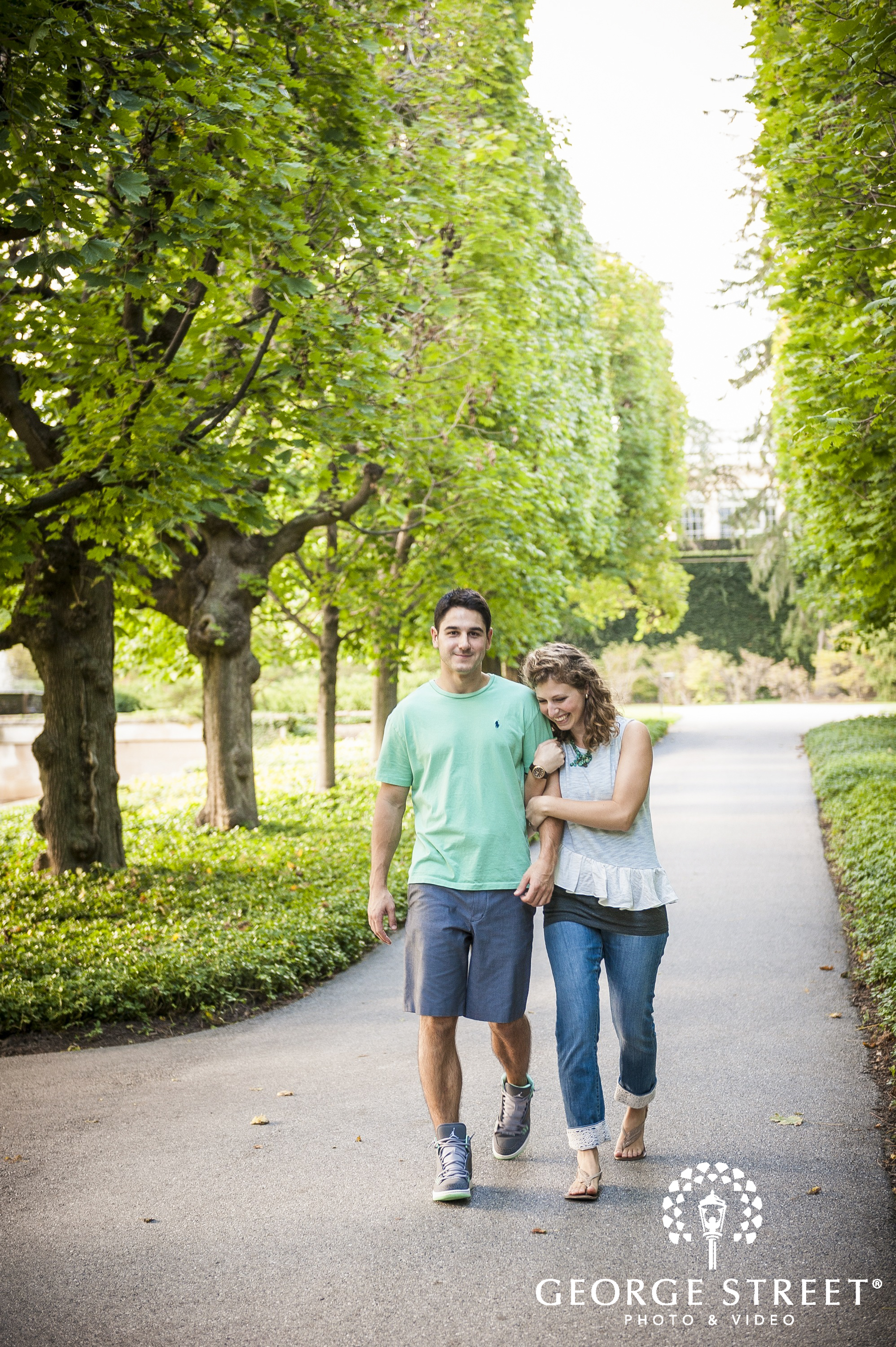 young couple in love walking in park